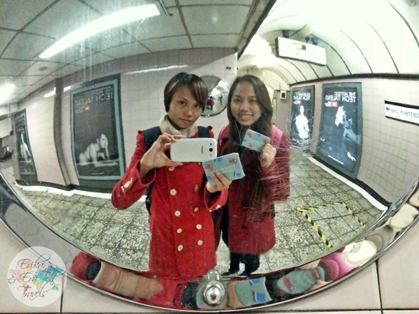ErikaEvaTohTravels-Posing with our Oyster cards in the tube station-London
